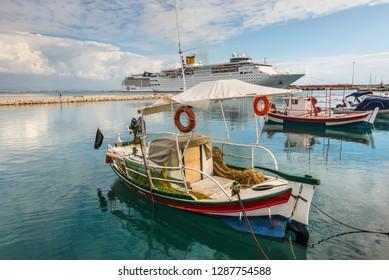Katakolon, Greece - October 31, 2017: Fishing boats and Costa neoClassica Cruise Ship moored in the port of the Katakolon (Olimpia), Greece.