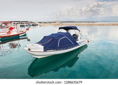 Katakolon, Greece - October 31, 2017: Speed boat moored in the port of the Katakolon (Olimpia), Greece.