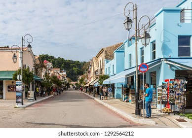 Katakolon, Greece - October 31, 2017: Tourists on the shopping street in the small charming town of Katakolon. The port of Katakolon or Katakolo is a popular stop for cruise ships.