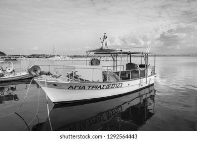 Katakolon, Greece - October 31, 2017: Fishing boats moored in the port of the Katakolon (Olimpia), Greece. Black and white photography.