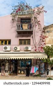Katakolon, Greece - October 31, 2017: The shopping street in the small charming town of Katakolon. The port of Katakolon or Katakolo is a popular stop for cruise ships.
