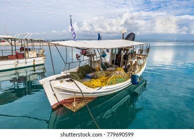 Katakolon, Greece - October 31, 2017: Traditional colorful wooden fishing boats in harbor of the Katakolon (Olimpia), Greece.