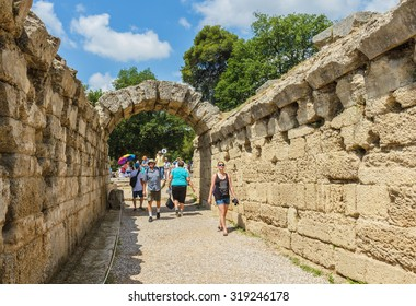 KATAKOLON (OLYMPIA), GREECE- JUNE10: Unidentified tourists visiting ruin of Olympia; the birth place of Olympic games in Katakolon, Greece on June 10, 2015.