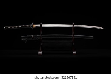Katana sward in the stand on the black background
