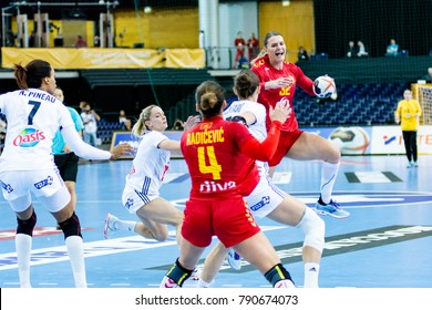 Katarina Bulatovic from Montenegro in attack at women handball game between France vs Montenegro . Final score : 25 - 22 at IHF World Championship, Germany 2017 - Quarter Finals, Leipzig on 12.12.2017