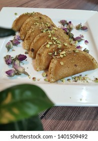 Katayef is the traditional Arabic dessert in the month of Ramadan, it's basically a type of bread stuffed by various types of creams, cheese, nuts... then fried then dipped in a sugar syrup.