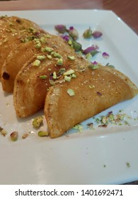 katayef is the traditional Arabic dessert in the month of Ramadan, it's a type of bread stuffed with cheese, cream or nuts then fried and dipped in sugar syrup.
