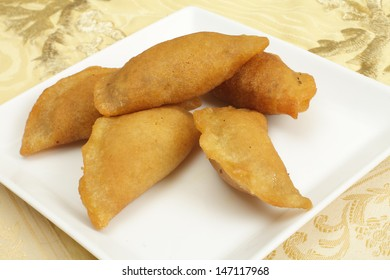 Katayef is the traditional sweet for the Muslim holy month of Ramadan throughout the Arab world. It is a kind of pancake that is folder over a stuffing and squeezed tight.