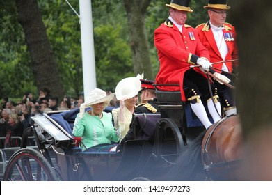 kate middleton  & Prince Harry stock, London uk,  8 June 2019- kate middleton camilla parker bowles holding hats in wind, Prince Harry  Trooping the colour Royal Family Buckingham Palace Press photo
