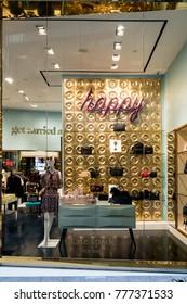 Kate spade shop at Emquatier, Bangkok, Thailand, Oct 15, 2017 : Luxury and fashionable brand window display. Casual woman clothings and bags showcase through mirror in front of the store.