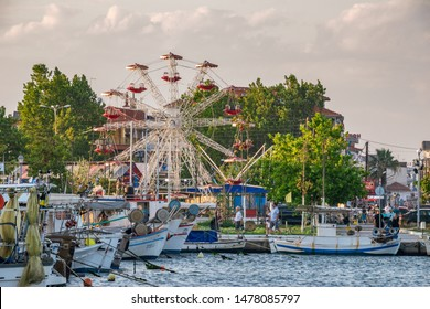 KATERINI, GREECE - JULY 2019: The Marina of Katerini, Pieria. View of seaside town Paralia Katerini near the Olympic Coast with fishing boats and ships in small bay, city attraction at sunset.