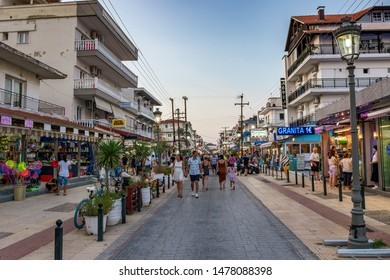 KATERINI, GREECE - JULY 2019: Scenic view of the seaside town Paralia Katerini near the Olympic Coast with tourists and visitors walking along the pedestrian streets in the Summer.