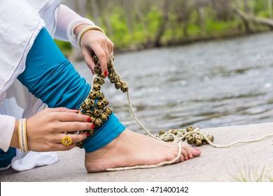Kathak Girl tying ghungaroo