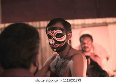 Kathakali artist with black vesham makeup before a performance on 7th January 2017 in Bengaluru,India