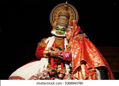 Kathakali artist Kalamandalam Gopi plays a noble king embracing his wife in Bangalore,India on May 3,2018.