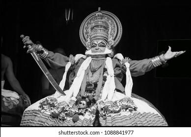 Kathakali artist Kalamandalam Gopi plays a noble king showcasing his strength with his hands  in Bangalore,India on May 3,2018.