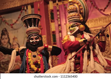 A kathakali artist playing as lord shiva explains his intentions as Arjuna is prepared to attack him during a performance on 7th January 2017 in Bengaluru,India