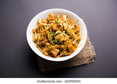 Kathal, Fanas ki Sukhi Sabzi or Bhaji known as  Spicy Jackfruit dry Vegetable recipe, served in a white bowl over moody background. Selective focus