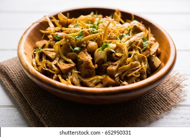 Kathal, Fanas ki Sukhi Sabzi or Bhaji known as  Spicy Jackfruit dry Vegetable recipe, served in a wooden bowl over moody background. Selective focus