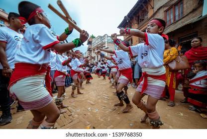 Kathmandu, Bhaktapur district, Nepal. August 16, 2016. Celebration of Gai Jatra Festival. Dancers with sticks perform a ritual dance. Bhaktapur.