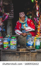 Kathmandu, Bhaktapur district, Nepal. December 28, 2019. A old man sits in the shop, street of thimi, early cold winter morning. Bhaktapur, thimi.