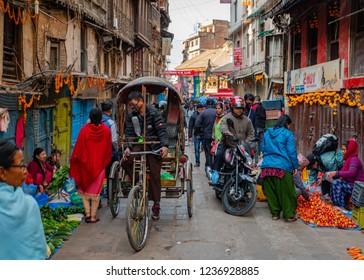 Kathmandu city / Nepal - 10 November 2018: Group of different people on the neighbourhood of Thamel district, the most popular tourist destination in Kathmandu