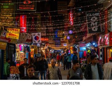 Kathmandu city / Nepal - 9 November 2018: Group of different people on the neighbourhood at night , Thamel district, the most popular tourist destination in Kathmandu