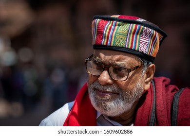 Kathmandu, Kathmandu/Nepal - Jan 08, 2020: An Old Nepali Man wearing colorful Nepali Cap and smile on face at day time with daylight