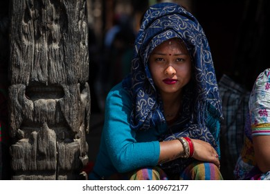 Kathmandu, Kathmandu/Nepal - Jan 08, 2020: A young Nepali Girl wearing blue dress sitting and looking at camera