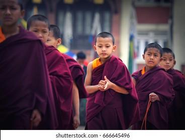 KATHMANDU - MAY 10: Buddhist monks pray at the Boudha stupa area on 10 May, 2017 in Kathmandu, Nepal. The Boudha stupa area is the most important Buddhist center  in Nepal.