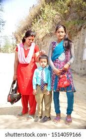 KATHMANDU - NEPAL / 04.22.2102: Nepali family from a village near Kathmandu, mother and children