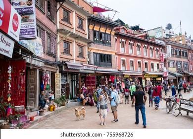 Kathmandu, Nepal - 06 October 2017: Tourists walk around the square full of souvenirs shops at the Boudhanath in Kathmandu, Nepal.