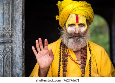 Kathmandu, Nepal - 06 October 2017: sadhu in colourful clothes and painted face in Kathmandu city, Nepal