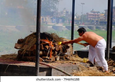 Kathmandu/ Nepal 07 14 2017 Burning ceremony in temple. In Nepal death is a celebration of a new life. Men in the picture were preparing to burn their father's body.