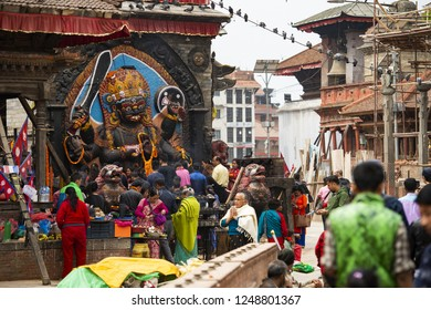 KATHMANDU - NEPAL - 18 APRIL 2018. Devotees worshiping Kal Bhairav in Kathmandu Durbar Square during the the Nepalese New Year 2073 Festival. Kathmandu is the capital city of Nepal.