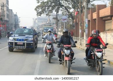 Kathmandu, Nepal, 20 December 2018. Street traffic, car and motorcycles