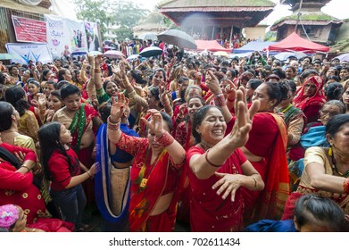 Kathmandu, Nepal, 24 August 2017 - Hartalika Teej - holiday celebrated mostly by girls and women with songs, dancing and prayer rituals, usually wearing red saree.