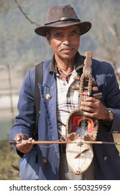 KATHMANDU, NEPAL - 8 FEBRUARY 2014 : Portrait of unidentified  nepalese man in traditional dress at street of Kathmandu, Nepal.