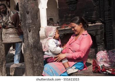 KATHMANDU, NEPAL - 8 FEBRUARY 2014 : Portrait of unidentified beautiful Nepalese woman in traditional dress at street of Kathmandu, Nepal.