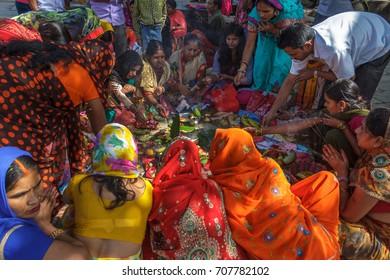 KATHMANDU, NEPAL - 9/26/2015: Hindu women in traditional sari sit together during Indra Jatra at Durbar Square in Kathmandu, Nepal.
