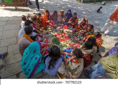 KATHMANDU, NEPAL - 9/26/2015: Hindu women in traditional sari sit in a circle at Durbar Square in Kathmandu, Nepal.