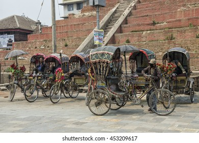 Kathmandu, Nepal - April 13, 2016: Group of rickshaws by the street of Durbar Square in Kathmandu.