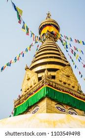 KATHMANDU, NEPAL - April 16, 2018:The Swayambhunath stupa, popularly known as the Monkey Temple, an important pilgrimage site for both Buddhists and Hindus in Kathmandu, Nepal.