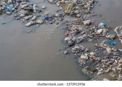 Kathmandu / Nepal - April 18 2019: A river in the capital filled with garbage