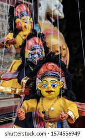 KATHMANDU, NEPAL - APRIL 22, 2014: A traditional Nepal souvenir is a doll with the image of a Hindu god on strings.