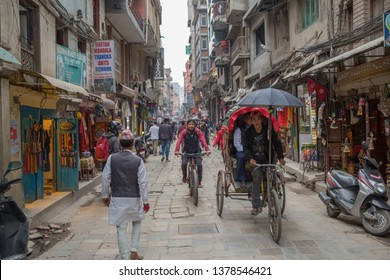 Kathmandu / Nepal - April 22 2019: A bicycle rickshaw in the capital on a cloudy afternoon.