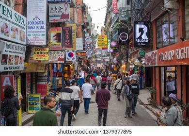 Kathmandu / Nepal - April 22 2019: A busy street in downtown Kathmandu on a late afternoon.
