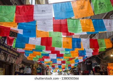 Kathmandu / Nepal - April 22 2019:  Traditional Nepalese flags hanging above a road in the capital