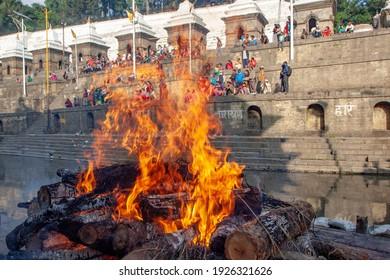 Kathmandu, Nepal - April 28, 2015: Relatives cremating April 25, 2015 earthquake victims on the bank of bagmati river behind the Pashupathinath Temple at Pashupati Aryaghat.