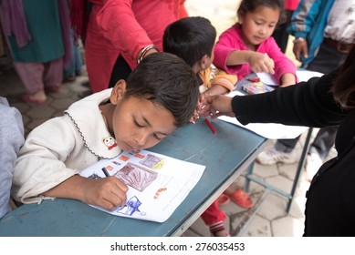 KATHMANDU, NEPAL - APRIL 30, 2015: childern drawing at basketball field in Bakhtapur school, Nepal suffered a magnitude 7.8 earthquake killing over 7,000 people and injuring thousands more.